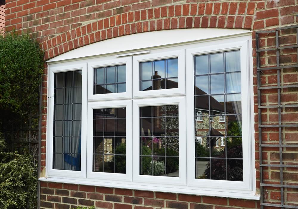 smooth white interior UPVC WINDOW grained cream exterior